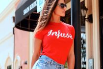 Charming female model posing in red tshirt and shorts
