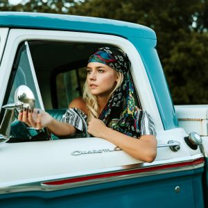 Beautiful and bold girl in a pickup truck