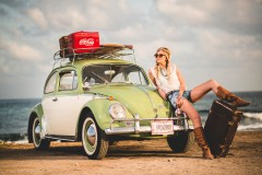 Beautiful model with vintage car and leather boots