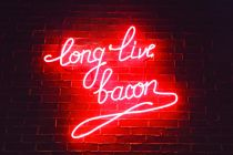 Long live bacon – red neon on a brick wall
