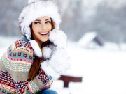 Young woman winter portrait in snow
