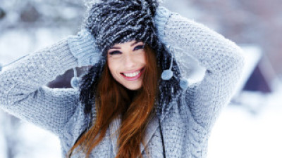 Beautiful smiling girl in winter park