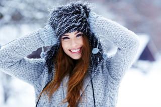 Beautiful smiling girl in winter park